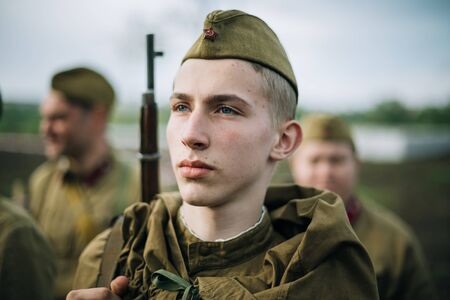 reenaction: MOGILEV, BELARUS - MAY, 08, 2015: Unidentified re-enactor dressed as Soviet soldier during events dedicated to 70th anniversary of the Victory of the Soviet people in the Great Patriotic War.