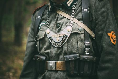 reenaction: SVETLAHORSK, BELARUS - JUNE 20, 2014: Uniform of a Feldgendarm during World War II, including gorget. The inscription on gorget Field Gendarmerie. Unidentified re-enactor dressed as German soldier. Editorial