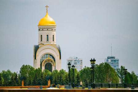 gold cross: Temple of St. George on Poklonnaya Hill in Victory Park In Moscow, Russia.