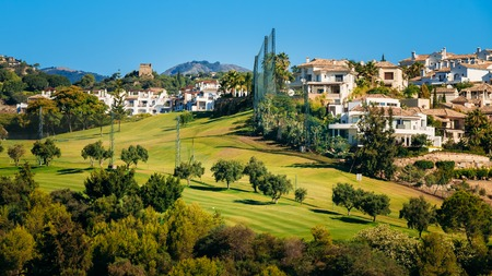 Panorama of Village With Whitewashed Houses In Benahavis, Malaga, Andalusia, Spain. Summer Cityscape. Sunny Day With Good Weather and Clear Blue Sky