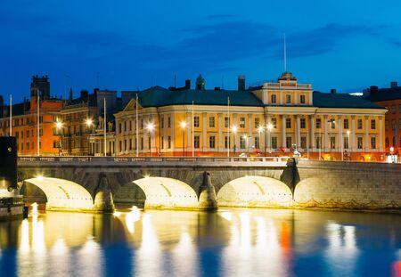 Night View Of Illuminated Old Norrbro Bridge in Stockholm, Sweden