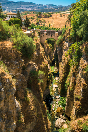 old bridge: The Puente Viejo - Old Bridge is oldest and smallest of three bridges that span the 120-metre deep chasm that carries Guadalevin River and divides city of Ronda, Province Of Malaga, Spain