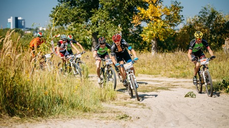 active people: Gomel, Belarus - August 9, 2015: Mountain Bike cyclist riding track at sunny day, healthy lifestyle active athlete doing sport.