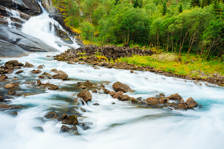 hardanger: Waterfall in the Valley of waterfalls in Norway. Husedalen Waterfalls were a series of four giant waterfalls on Kinso River flowing down from the Hardanger Plateau (Hardangervidda) to the South Fjord. Stock Photo