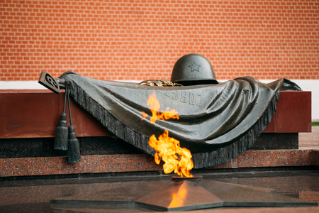tomb unknown soldier: Eternal Flame in Moscow at the Tomb of the Unknown Soldier in the Alexander Garden in Moscow close by Kremlin walls. Russia.