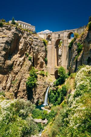 nuevo: The New Bridge - Puente Nuevo and waterfall in Ronda, Province Of Malaga, Spain Stock Photo
