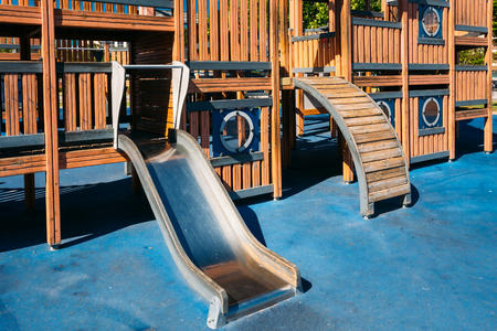 Child playground shaped old wooden pirate ship in park