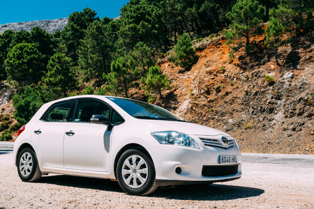 hatchback: MIJAS, SPAIN - JUNE 19, 2015: White color Toyota Auris car on Spain nature landscape. The Toyota Auris is a compact hatchback derived from the Toyota Corolla