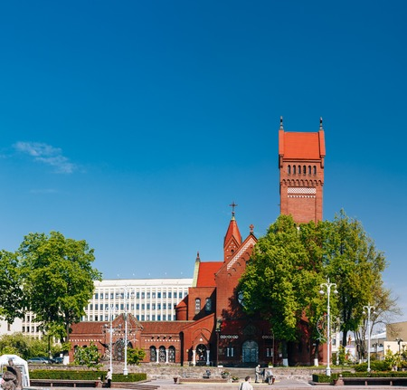 helen: MINSK, BELARUS - May 20, 2015: Belarussian Roman Catholic Church Of Saints Simon And Helen - Red Church-  On Independence Square In Minsk, Belarus Stock Photo