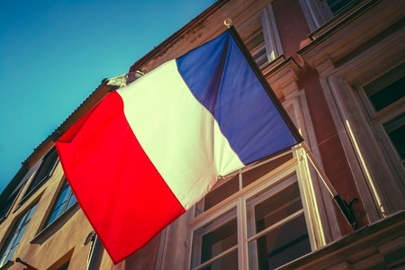 local government: French Tricolours Flag Decorate A Local Government Building In Paris, France. Toned, Instant Photo Stock Photo