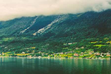 hardangerfjord: Scandinavian village on shore of Hardangerfjord. The Hardangerfjord is the fourth longest fjord in the world, and the second longest fjord in Norway.