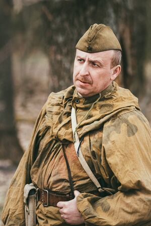 reenaction: PRIBOR, BELARUS - April, 04, 2015: Unidentified re-enactor dressed as Soviet soldier scout in camouflage during events dedicated to 70th anniversary of the liberation of Belarus from Nazi invaders
