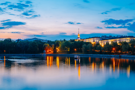 svisloch: View on the citys waterfront and the Kommunisticheskaya street in Minsk, Belarus. Svisloch River at evening time.