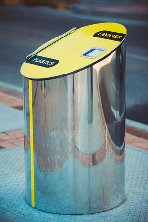cylindrical: Metal Waste bin, trash can for separate waste outdoor. Cylindrical Bin For Collection Of Recycle Materials. Stock Photo