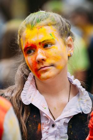 Gomel, Belarus - September 12, 2015: Girl having fun at Holi color festival in park