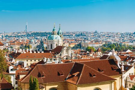 st nicholas cathedral: Aerial view of cityscape and St. Nicholas Church in Prague, Czech Republic.