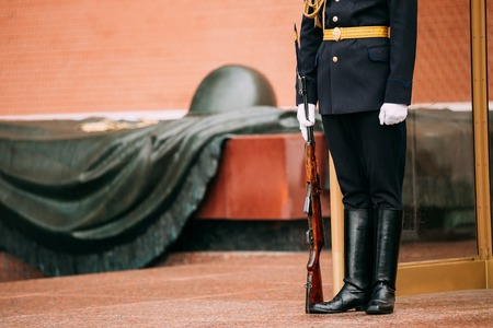 tomb of the unknown soldier: Post honor guard at the Eternal Flame in Moscow at the Tomb of the Unknown Soldier in the Alexander Garden in Moscow close by Kremlin walls Stock Photo