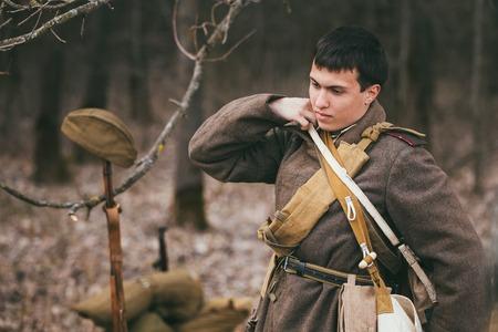 reenaction: PRIBOR, BELARUS - April, 04, 2015: Unidentified re-enactor dressed as Soviet soldier in overcoat