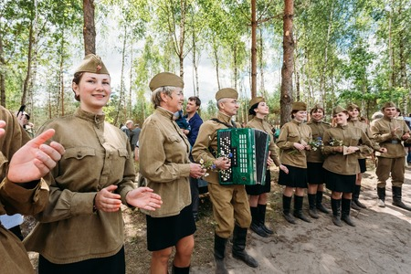 offensive: SVETLAHORSK, BELARUS - JUNE 21, 2014: Unidentified artists dressed as Soviet Russian soldiers dance during events dedicated to 70th anniversary of Soviet Belorussian offensive operation Bagration.