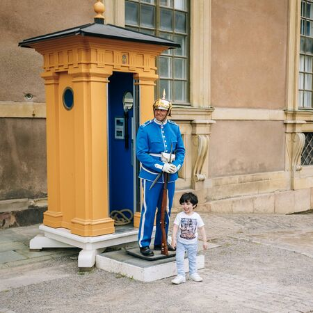 xvi: STOCKHOLM, SWEDEN - JULY 30, 2014: Tourists visit the Royal palace in Gamla Stan, where king Carl XVI Gustaf has his working office.