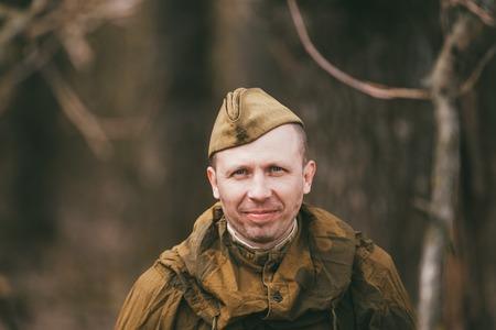 reenactor: PRIBOR, BELARUS - April, 04, 2015: Unidentified re-enactor dressed as Soviet soldier in camouflage