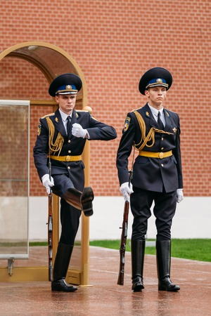 tomb of the unknown soldier: Moscow, Russia - May 24, 2015: Post honor guard at the Eternal Flame in Moscow at the Tomb of the Unknown Soldier in the Alexander Garden in Moscow close by Kremlin walls