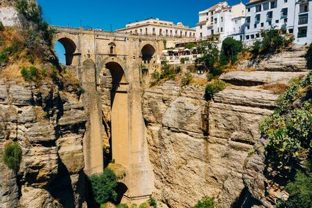 nuevo: The Puente Nuevo - New Bridge is newest and largest of three bridges that span the 120-metre-deep chasm that carries the Guadalevin River and divides city of Ronda, Province Of Malaga, Spain