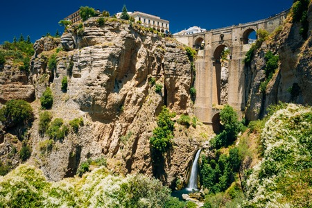 The New Bridge - Puente Nuevo and waterfall in Ronda, Province Of Malaga, Spain Archivio Fotografico