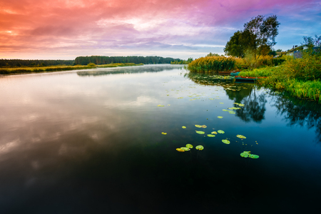 water fall: Calm Water Of Lake, River at Sunset time, Forest On Other Side. Landscape. Nature Background.