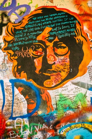 poem: Prague, Czech Republic - October 10, 2014: Famous place in Prague - The John Lennon Wall. Wall is filled with John Lennon inspired graffiti and lyrics from Beatles songs