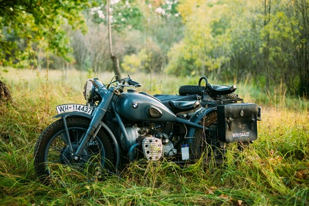 old motorcycle: Teryuha, Belarus - October 3, 2015: Old BMW R75 motorbike, motorcycle in summer forest Editorial