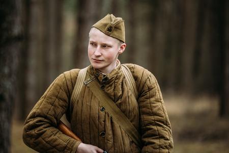 reenaction: PRIBOR, BELARUS - April, 04, 2015: Unidentified re-enactor dressed as Russian Soviet soldier in camouflage