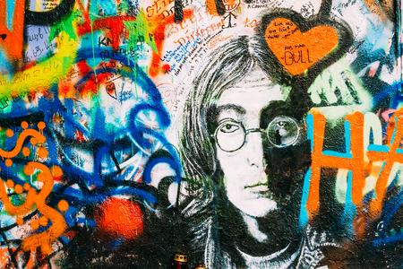 lyrics: Prague, Czech Republic - October 10, 2014: Famous place in Prague - The John Lennon Wall. Wall is filled with John Lennon inspired graffiti and lyrics from Beatles songs