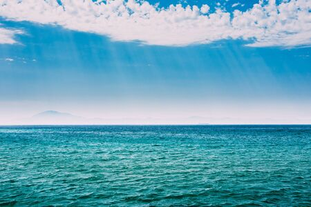 ocean water: Sea Ocean And Blue Sky Background With Cloudscape