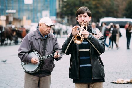 artist: PRAGUE, CZECH REPUBLIC - OCTOBER 10, 2014: Street Busker performing jazz songs at the Old Town Square in Prague. Busking is legal form of earning money on Prague Streets.