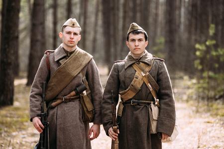 reenaction: PRIBOR, BELARUS - April, 04, 2015: Two unidentified re-enactors dressed as Russian Soviet soldiers in camouflage