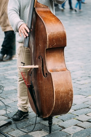busker: Street Busker performing jazz songs. Close up of contrabass Stock Photo