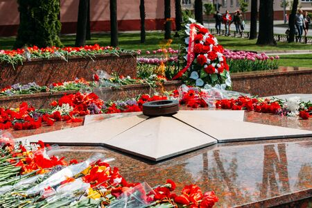 communal: Wreaths and flowers lie on a communal grave of Soviet soldiers who died during the liberation of Gomel and Belarus from German invaders in World War II.