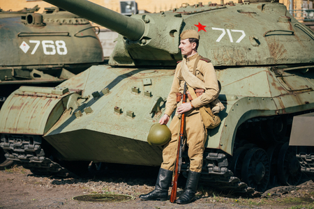 rifleman: Gomel, Belarus - May 9, 2015: Unidentified re-enactor dressed as Soviet russian soldier posing near heavy tank IS-3 Editorial