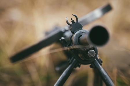 war: Soviet russian military ammunition - machine gun of World War II on ground.