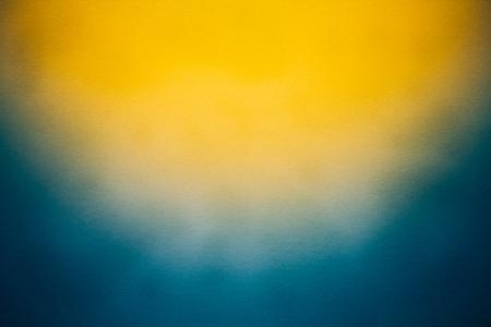 Abstracte oude blauwe en gele kleur papier als achtergrond voor het ontwerp artwork