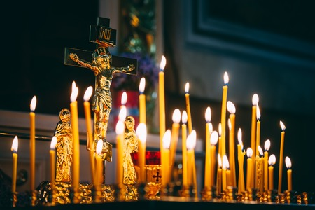 easter candle is burning: Group of burning church candles at dark background