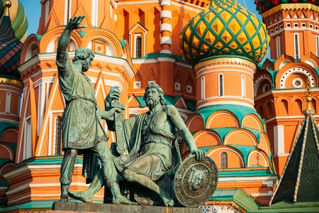 minin: Monument to Minin and Pozharsky on the background of the Saint Basils Cathedral in Red Square in Moscow, Russia. Stock Photo