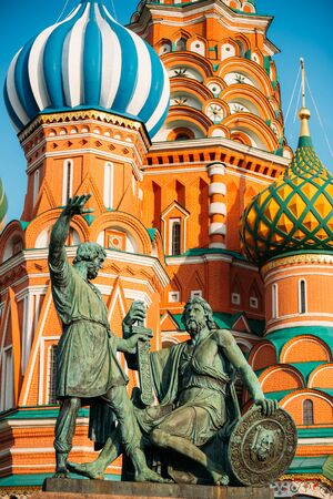 red square: Monument to Minin and Pozharsky on the background of the Saint Basils Cathedral in Red Square in Moscow, Russia. Stock Photo