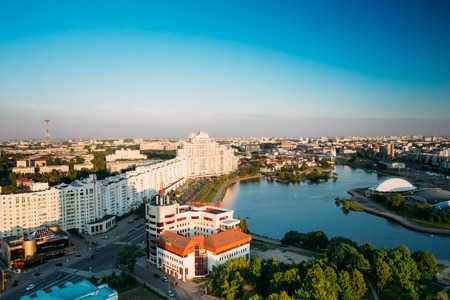 svisloch: MINSK, BELARUS - June 2, 2015: Aerial view, cityscape of Minsk, Belarus. Summer season sunset time. Nyamiha Nemiga district