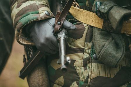 german soldier: Close up of german military ammunition of a German soldier. Unidentified re-enactors dressed as World War II German soldiers standing order.