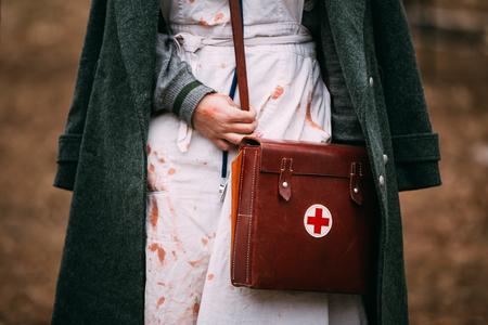 reenaction: Unidentified re-enactor wears historical German Red Cross - Deutsches Rotes Kreuz - DRK uniform