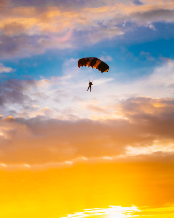 Skydiver On Colorful Parachute In Sunny Sunset Sunrise Sky. Active Lifestyle