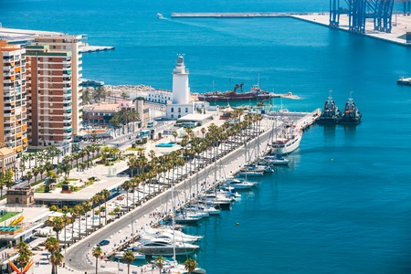 spain: Cityscape aerial view of Malaga, Spain. Lighthouse and marina.