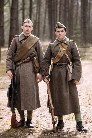 reenaction: PRIBOR, BELARUS - April 04, 2015: Two unidentified re-enactors dressed as Russian Soviet soldiers in camouflage